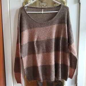 Women's FREE PEOPLE sheer sweater.